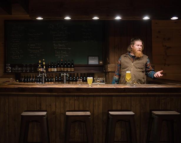 Evan Watson in the new Plan Bee taproom. - DEREK DELLINGER