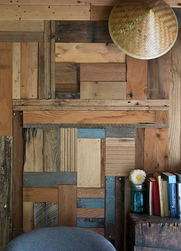 An interior wall of Truscott and Covelli's garage turned studio/ shed. Covelli built the wood-scrap-insulated walls from pieces he salvaged from the property and donations from friends. - DEBORAH DEGRAFFENREID