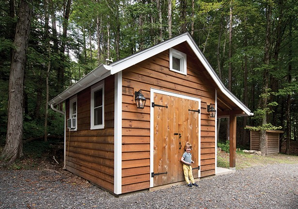 """Hudson in front of the shed Bollman built. """"Support systems are so important,"""" explains Bollman. """"This is not just my story but the story of how all these pieces came together—it's a really great neighborhood."""" - DEBORAH DEGRAFFENREID"""