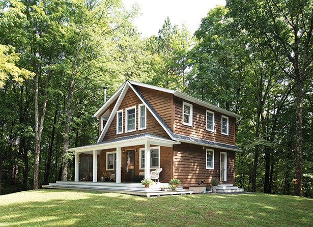"Aaron Bollman and Lisa Nicholas built their classically detailed cottage on a quiet country lane. - The design was inspired by the property's previous cottage and built from wood salvaged from - its teardown. ""It's an evolution of what was here,"" explains Bollman. - DEBORAH DEGRAFFENREID"