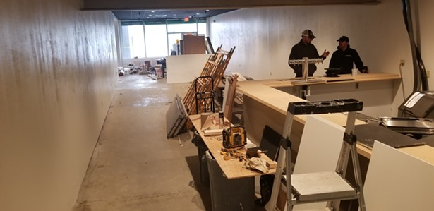 The bar and lobby under construction.