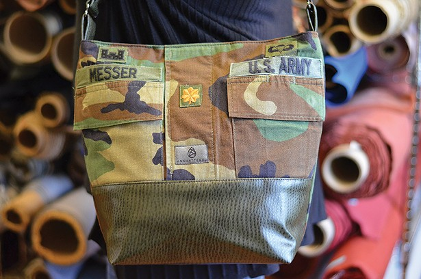 A tote made from a retired US Army uniform paired with manufacturing straps donated by Ultrafabrics in Tarrytown.