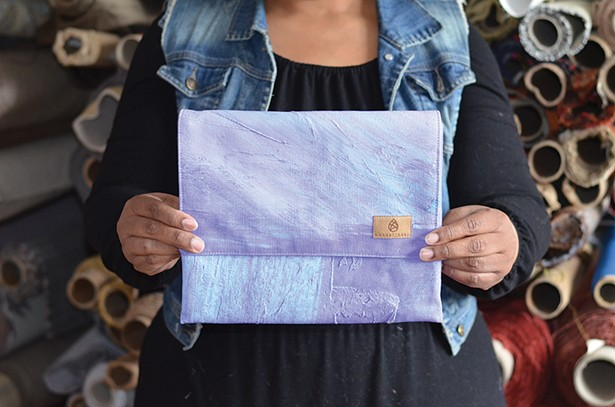 A handbag made from a backdrop from a Broadway show.