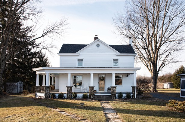 """The family's 1820s farmhouse, surrounded by ancient silver maples, is one of the oldest homes in the area.The original primitive Colonial architecture includes many decorative details added over the years.Although only an acre in size, the homestead is surrounded by orchards and fields, making it feel expansive. """"I love these trees,"""" says Rodabaugh.""""They are some of the oldest around."""""""