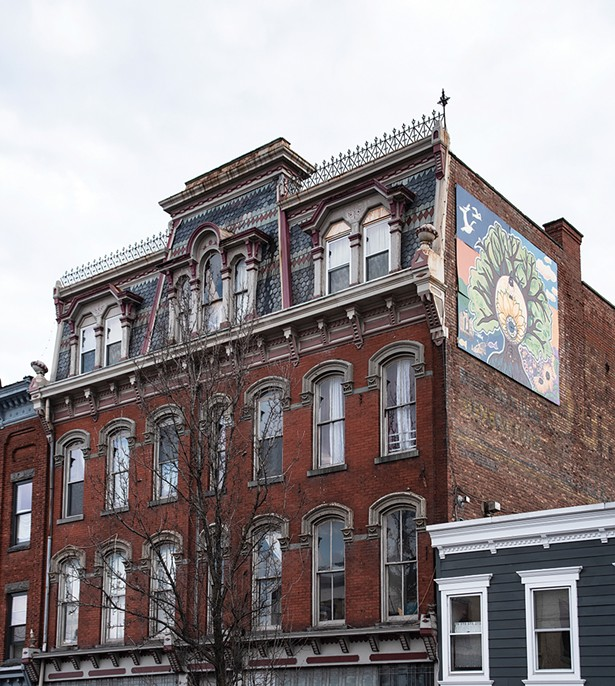 Bickman's loft occupies the top three floors of a former Odd Fellows Temple. Bickman's mural Timeless Saugerties compliments the building's 19th century gothic facade. Bickman painted the piece with 9 local young people during the summer of 2017 as part of her Mural Arts Program. - PHOTO BY DEBORAH DEGRAFFENREID
