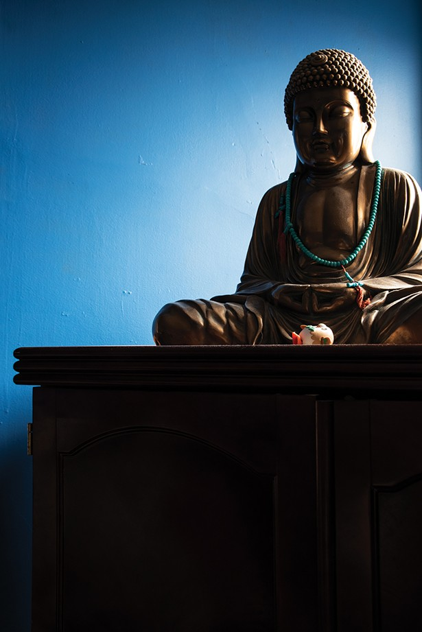 """A gift from her mother, a Buddha statue graces a corner of her guest room. """"I wake up every morning and make my gratitude list,"""" Bickman says. """"I am so grateful to have the best patrons in the world."""" - PHOTO BY DEBORAH DEGRAFFENREID"""