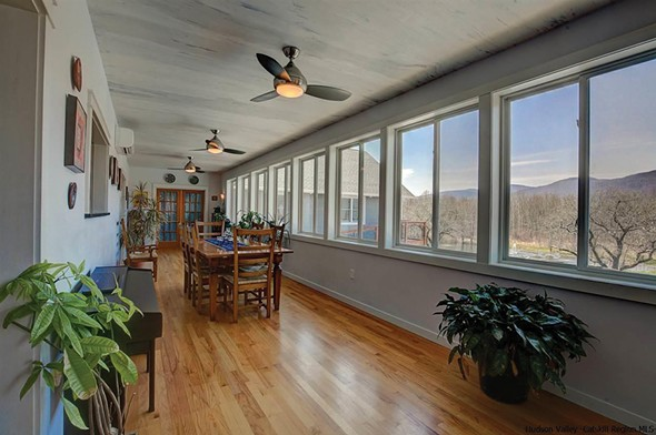 The dining room overlooks the backyard and mountains