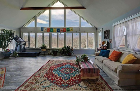 The great room offers lofty ceilings and a bank of windows.
