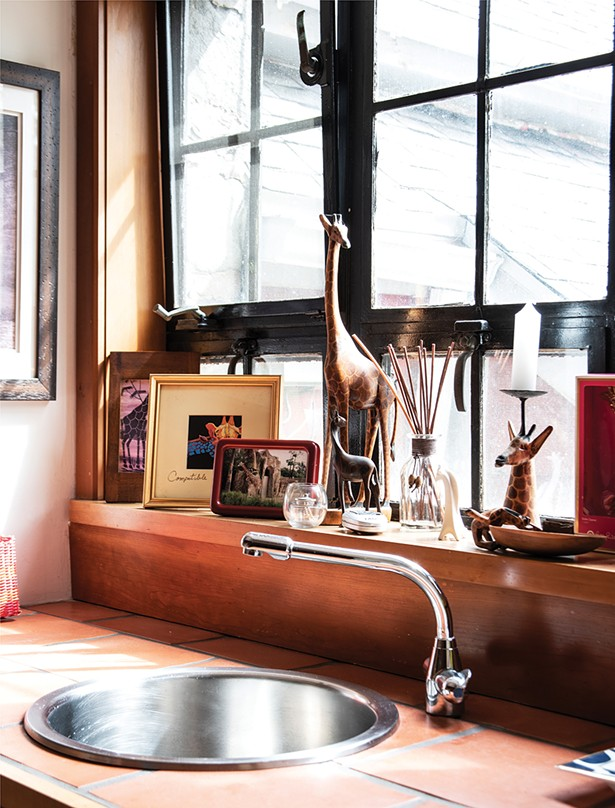 Stewart has decorated a small bar area off the - kitchen with her collection of giraffes. - PHOTO: DEBORAH DEGRAFFENREID