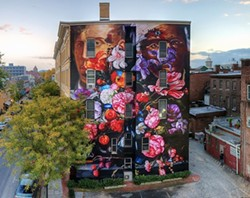 """Pronskstilleven,"" is a 2015 mural by Gaia, on the RUPCO building in Uptown Kingston"