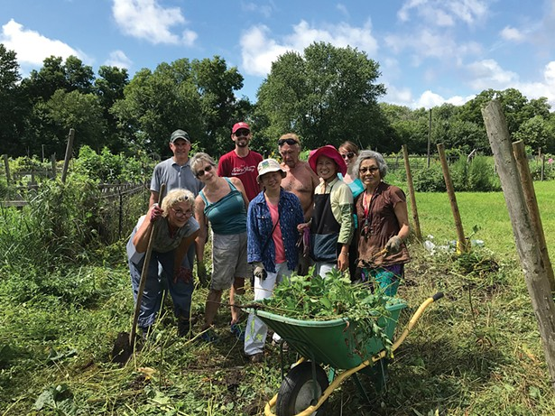 A clean-up crew at a New Paltz Gardens for Nutrition Community Work Day in 2018. - PHOTO: JAIMEE UHLENBROCK