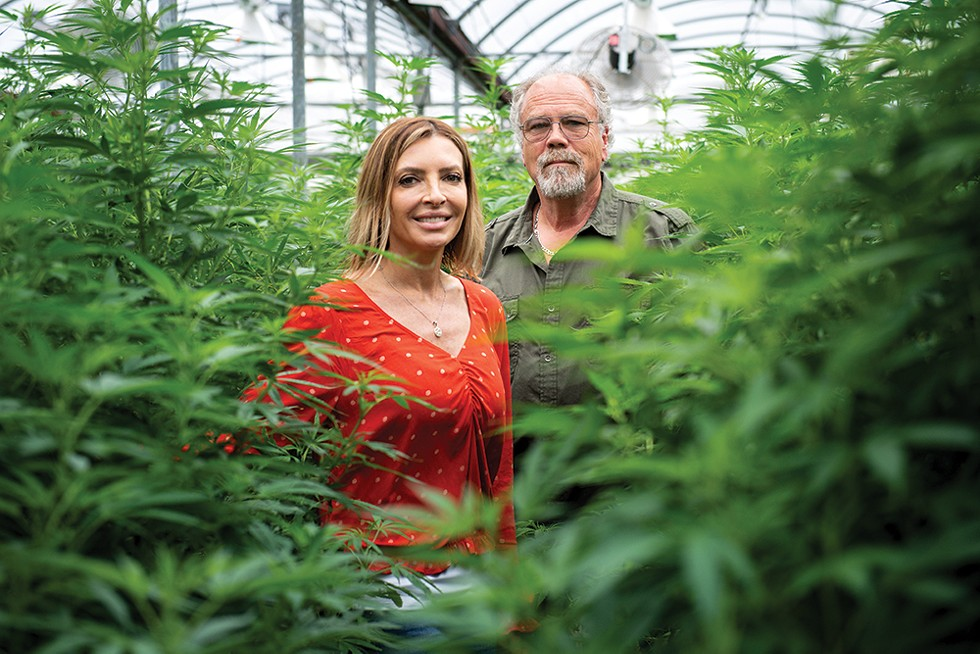 Michele Szymanski and Ed McCauley of Fusion CBD at their Warwick greenhouse. - PHOTO: CHRISTINE ASHBURN
