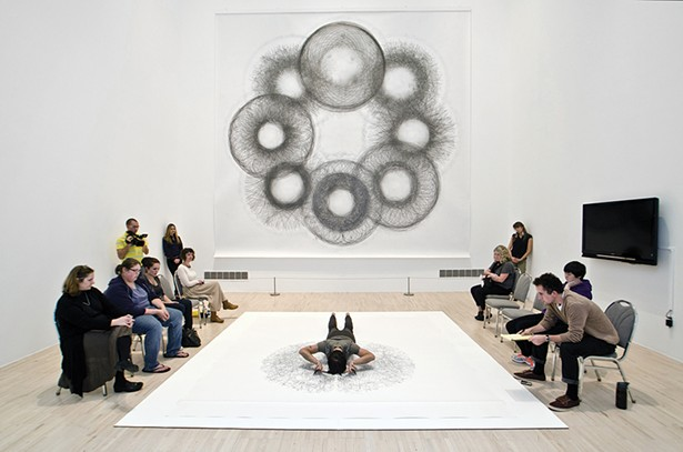Tony Orrico creating a Penwald Drawing, part of a series of bilateral drawings exploring the use of the body as a tool of measurement to inscribe geometries through movement. - PHOTO COURTESY OF THE HUDSON EYE FESTIVAL