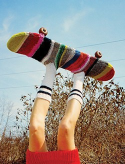 Top half of Aviona Carrigan wearing a skatesock designed by Marist student Erika Rothman and a dress designed by Alexa Wisnieski. - JERRY PENA