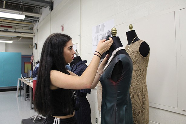 Deena McGarvey from New Paltz High School puts the finishing touches on her dress at the Ulster BOCES 2019 Fashion Design class's end-of-year gallery exhibit.