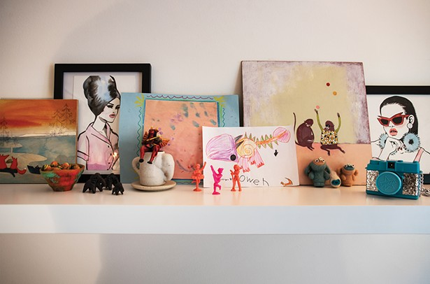 """A shelf in Davis's home office. She works in the - advertising industry in Manhattan. """"I've always loved art and making things, but I'm not a painter or illustrator,"""" she says. """"Working in design allows me to bring together different styles of illustration and photography then add typography to communicate a message."""" - PHOTO: DEBORAH DEGRAFFENREID"""