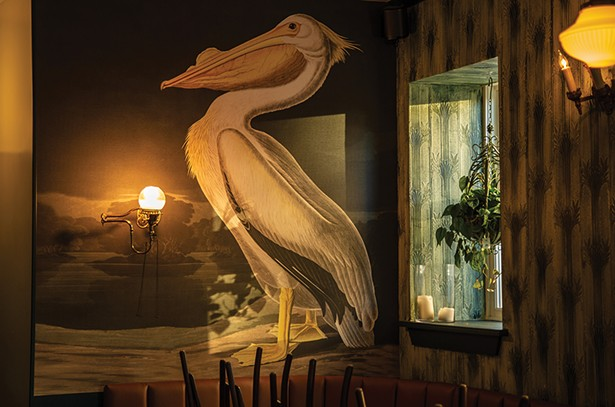 A mural of a stately pelican presides over - the restaurant from the back wall - PHOTO: BRIAN WOLFE