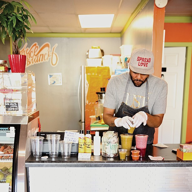 George Salter, co-owner of the Juice Branch - makes their signature juices for customers. - PHOTO: NIVA DORELL