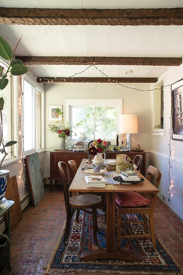 "The home's dining room can accommodate up to 14 people. Over the past year, the couple have hosted three eating events—a late summer harvest dinner, ""Eat the World"" and an oyster bar and welcome 2019 brunch—as well as five-course cooking workshops. ""We would like to collaborate with local venues to produce future eating events, to bring in more community from this beautiful region,"" says Lafferty. - PHOTO: DEBORAH DEGRAFFENREID"