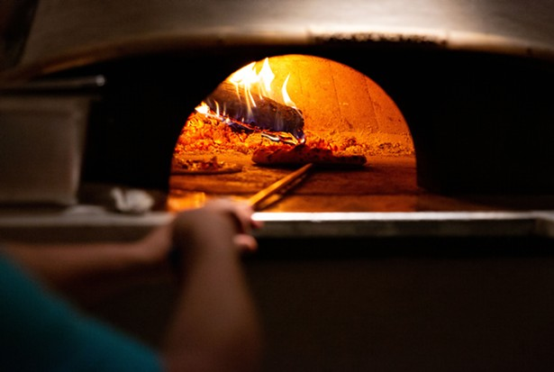 The wood-fired oven imported from Naples maintains a temperature of 800 degrees. A typical pizza take two minutes to cook. - LINDSAY TALLEY