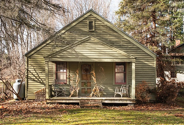 """The front porch of the property's original structure, once a summer cottage, looks across the road to preserved wetlands. """"The amount of - time I've been up here has just flown by,"""" Feinberg says. """"When I think about it, I've really accomplished a lot up here."""" - PHOTO: DEBORAH DEGRAFFENREID"""