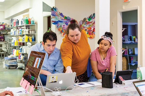 David Wong and Sarah Timberlake Taylor work with a student at The Art Effect in Poughkeepsie. The Art Effect, a merger of two longstanding arts nonprofits, Mill Street Loft and Spark Media Project, works in arts education and youth development across the region. - PHOTO: ANNA SIROTA