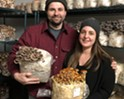 Grace and Devon with their mushrooms.
