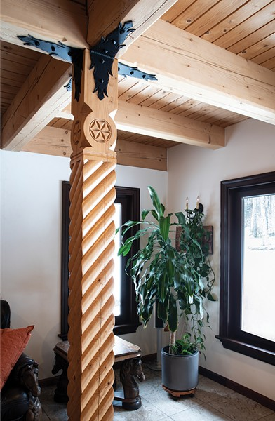 """Wanting to create a Zakopane home that was as authentic as possible, Laroux's Polish born parents Benjamin and Juliette Laroux commissioned a majority of the 8,000 square foot building's materials from Podhale and then - erected the structure on a Polish mountainside. - """"All the carvings were hand done on the spot in - the mountains there,"""" says Laroux. - PHOTO BY DEBORAH DEGRAFFENREID"""