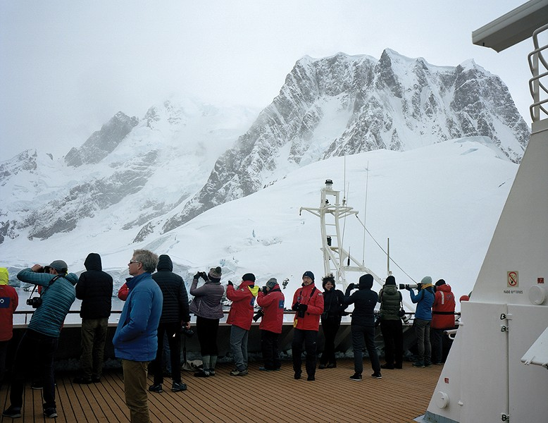 More than 40,000 tourists visit Antarctica each - year. Over the next five years, with projected - milder weather and reduced sea ice, the industry - is expected to grow by 40 percent. - PHOTO BY MADELINE COTTINGHAM