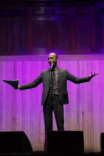 """Cecil Baldwin as Cecil Palmer in the live Welcome to Night Vale episode """"The Investigators"""". - PHOTO BY SCEPTRE COURTESY OF WIKIPEDIA, CC BY-SA 4.0"""