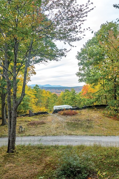"""The home features a stunning view of the nearby Catskills. Shea has started multiple gardens near the house, but the only gardening that's been successful is his pepper patch located in the property's sunniest spot. """"I sense a greenhouse is in our future,"""" says Horowitz. - WINONA BARTON-BALLENTINE"""