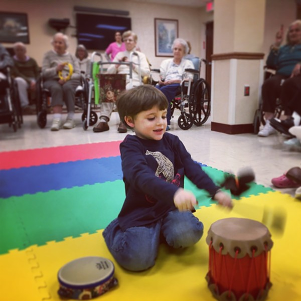 4-year-old Iggy enjoys Music Together with young and old classmates at the Thompson House - HILLARY HARVEY