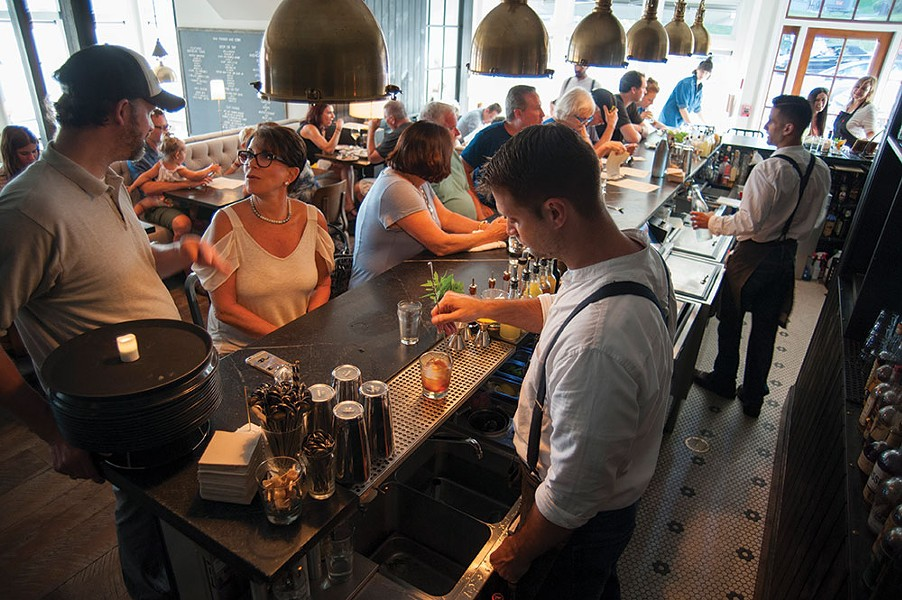 A.J. stirring a cocktail at Wm. Farmer and Sons in Hudson. - ROY GUMPEL