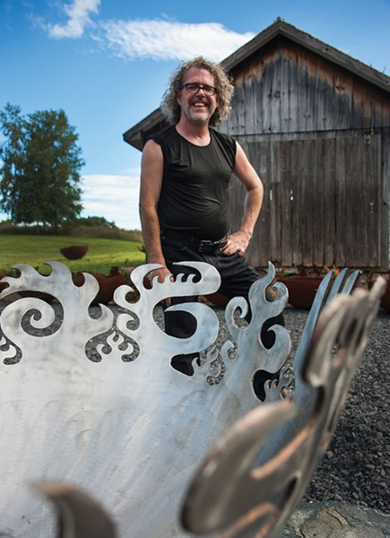 John T. Unger with a metal fire bowl of his construction. - ROY GUMPEL