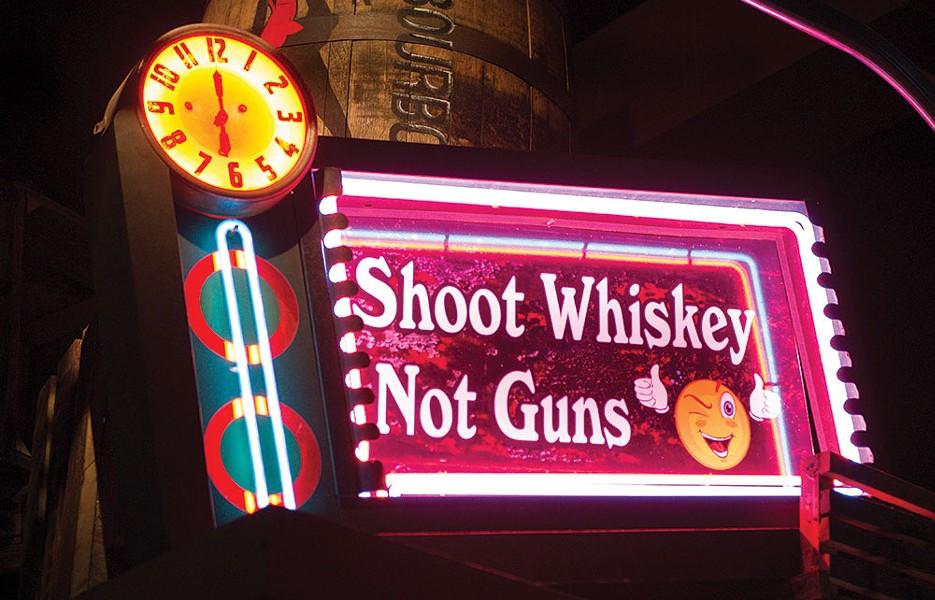 Above the bar at Buns-n-Bourbon in Peekskill. - CHRISTINE ASHBURN