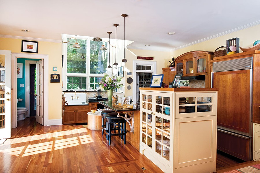 The couple converted Frasier's original north facing painting studio into a large kitchen, adding an arch of windows and skylights over the kitchen sink. - DEBORAH DEGRAFFENREID