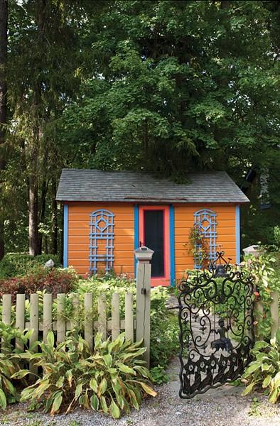 O'Garden's writing cottage nestled among trees on the property. - DEBORAH DEGRAFFENREID