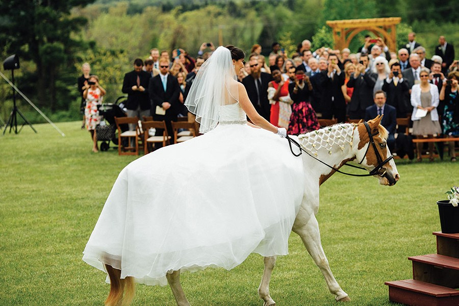 Meryl Gordon rides her horse Lucky down the aisle on her parents's horse farm, High & Mighty Stables, in Ghent on May 21, 2016. - JESSE TURNQUIST