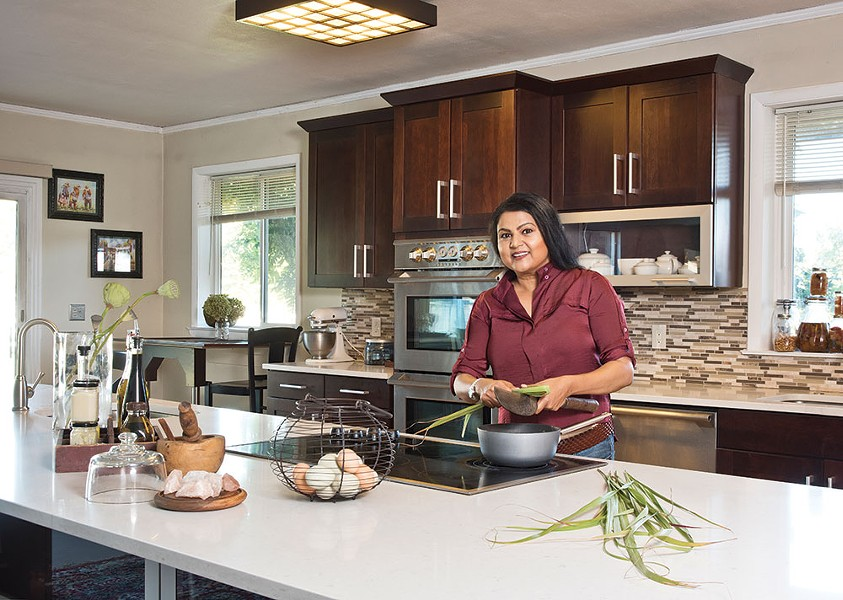 "Nirmala Narine in her farmhouse kitchen. She's been called the ""Indiana Jones of spices."" Narine likes the nickname, but adds, ""I've done much rougher stuff than him."" - DEBORAH DEGRAFFENREID"