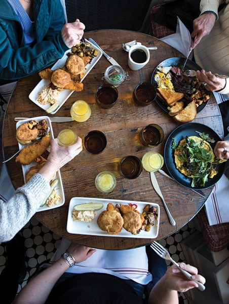 Sunday Brunch: Crispy Chicken Biscuit (housemade biscuit with crispy chicken, pimento cheese, bacon, and pickled fresno peppers), Sweet Potato & Goat Cheese Frittata(smoked onions, local greens), Steak and Eggs. - CHRISTINE ASHBURN