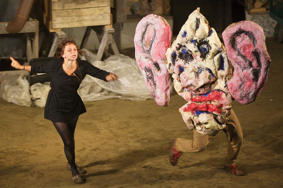 """The narrator(Esteli Kitchen) explains the function of gargoyle (Tyson Houseman) in the Bread & Puppet production of """"Faust 3,"""" performed at Time and Space Limited in Hudson. - MARK DANNENHAUER"""