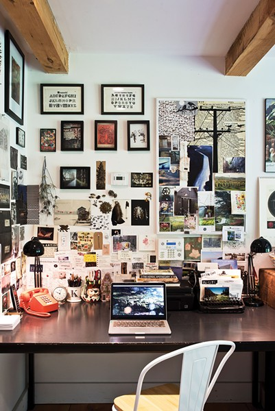 """The """"renovation station"""" at the entrance of their home.Cummings describes herself as""""part sentimentalist, part archivist.""""""""I like to remember things and I collect paper ephemera—everything eventually ends up turning into collages on the walls."""" - DEBORAH DEGRAFFENREID"""