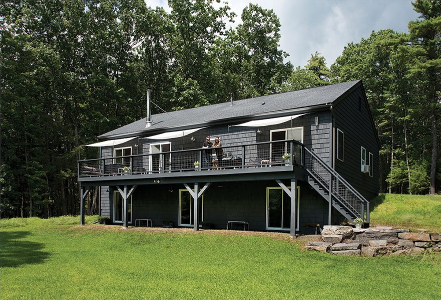 Kate Cummings and Griffin Stenger on the deck of their New Dutch Vernacular home.Their 12-acre property is bordered by a pond on one side and the beginnings of the Kripplebush Creek on the other. - DEBORAH DEGRAFFENREID