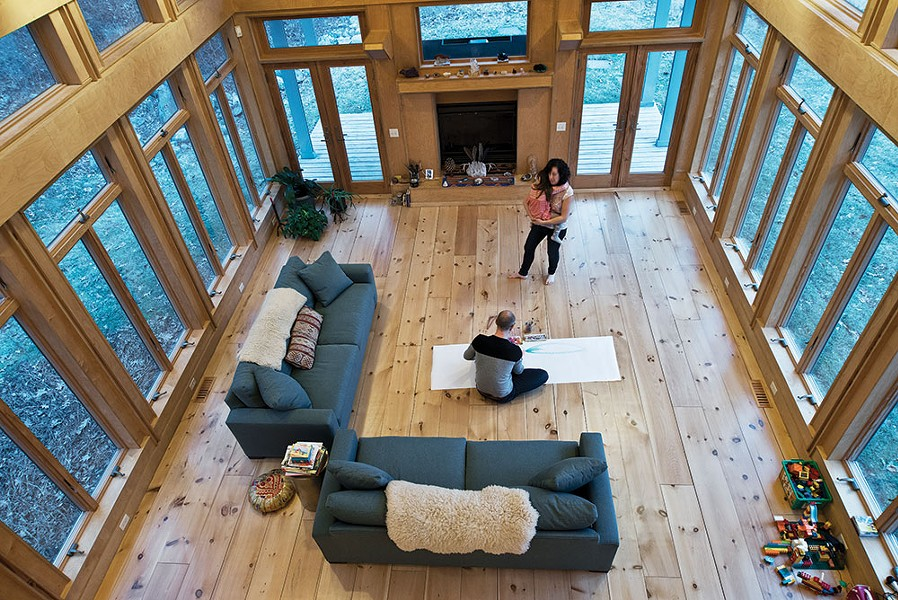 "The home's two-story main room is open to the upstairs loft. The bare floors are intentional. ""We are a dancing family,"" explains Diamond. ""We dance every day or we are in here making art."" - DEBORAH DEGRAFFENREID"