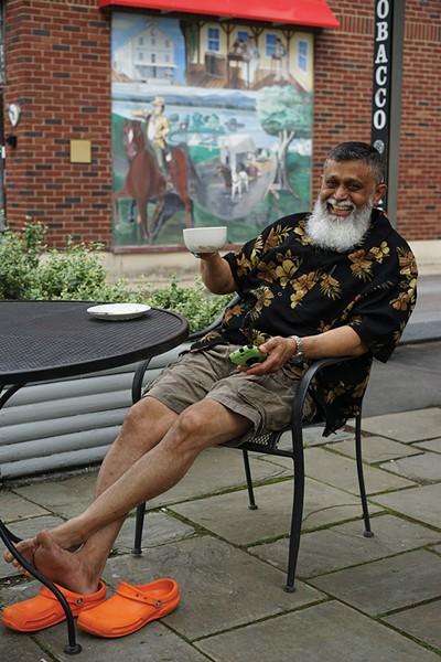 Nasir relaxing in Red Hook. - JOHN GARAY