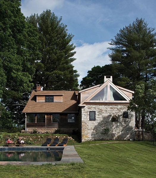 "Konstanze Zeller's rehabbed stone house. While others might have been daunted by the home's extensive fire damage and dilapidated state, Zeller saw pure potential and was glad the previous ""flipper"" had left the home relatively untouched. - DEBORAH DEGRAFFENREID"