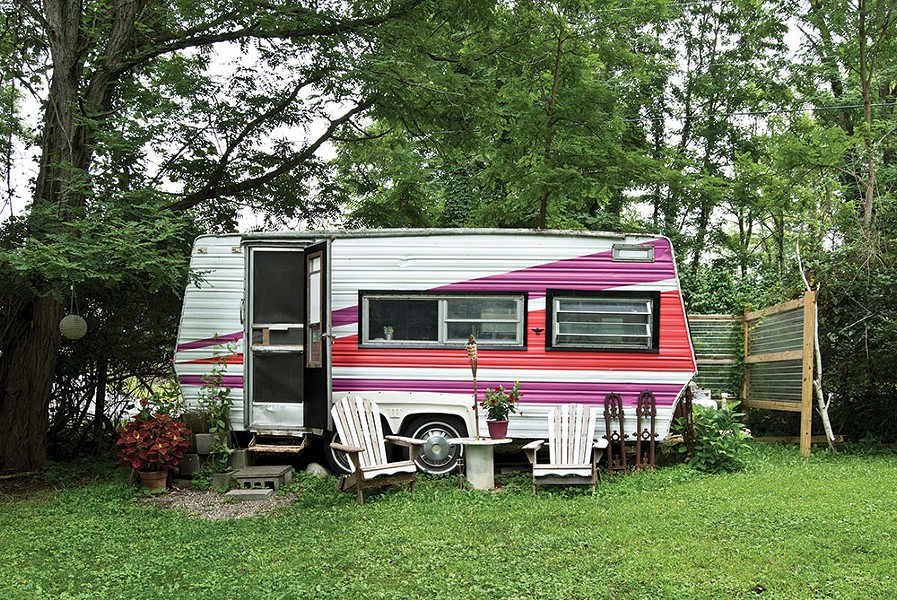 Covelli and Truscott's 17-foot 1982 Wilderness Camper is tucked away on a corner of their five-and-a-half-acre property. Bought secondhand in New Jersey, they drove it Upstate during a tornado and fully renovated it last year. Now it includes a sleeping area, kitchenette, and lounge. - DEBORAH DEGRAFFENREID