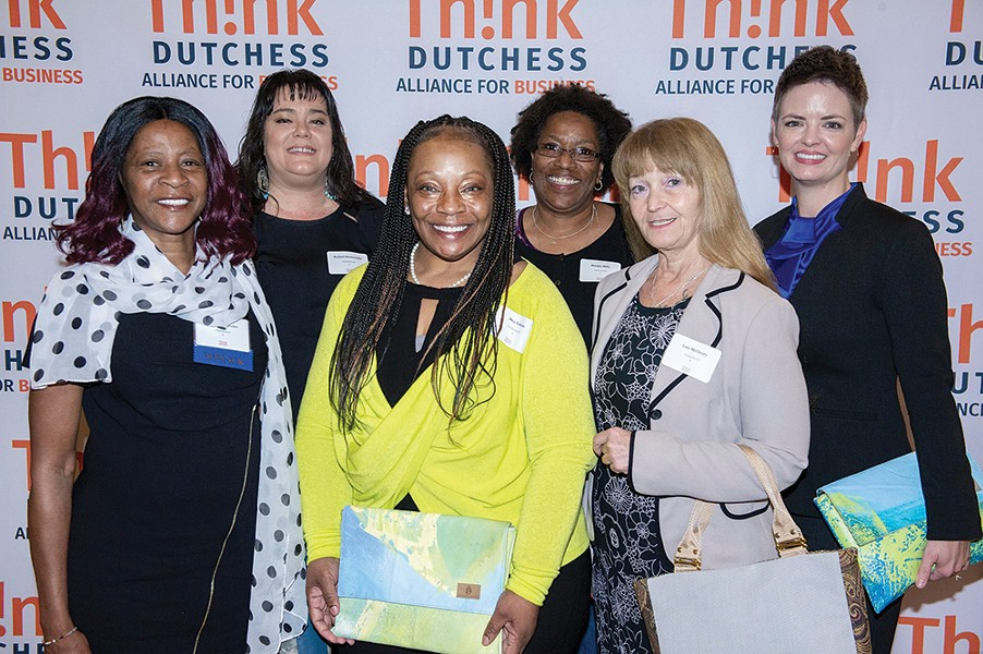 "CEO Kelly Lyndgaard (right) with members of the Unshattered team after winning ""Best Nonprofit of the Year"" at the Think Dutchess awards in November. - UNSHATTERED"