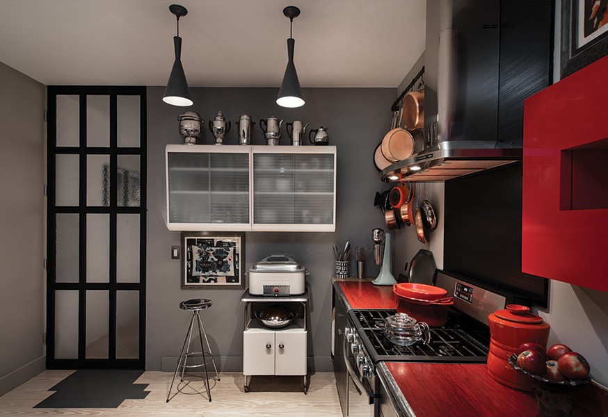 """""""Aunt Linda's"""" kitchen cabinets surrounded by some of Gillette's favorite vintage kitchen equipment and topped with a few coffee pots. - DEBORAH DEGRAFFENREID"""