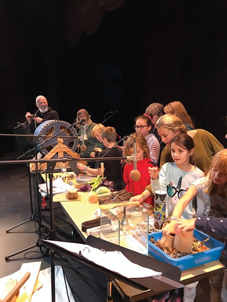 """John Prusinski, in the back, was a foley artist for a Daniel's Art Party/Red Room Radio Redu, radio theater production of Bram Stoker's """"Dracula."""" The audience was invited to check out the foley table after the show."""